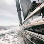 photograph of superyacht cruising at speed on the sea